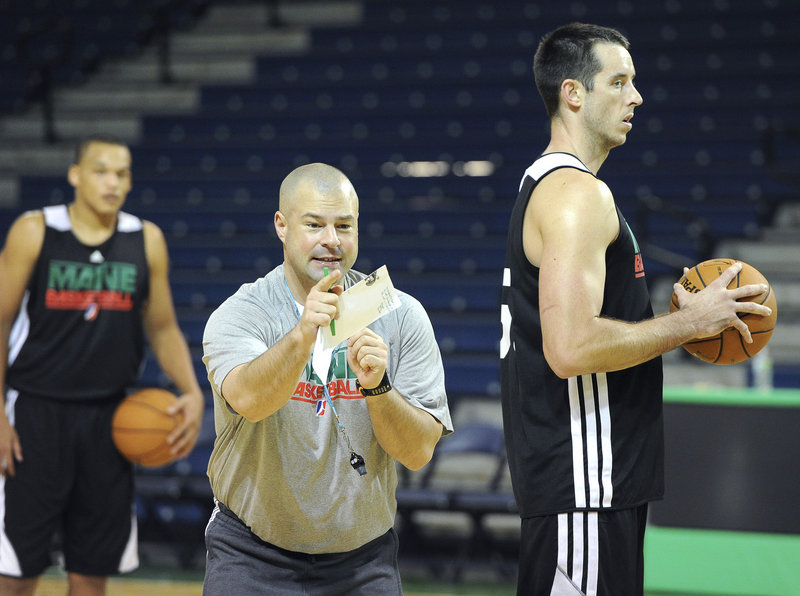 Mike Taylor provides some instruction to the Red Claws on Tuesday. The first-year Maine coach replaces Dave Leitao.