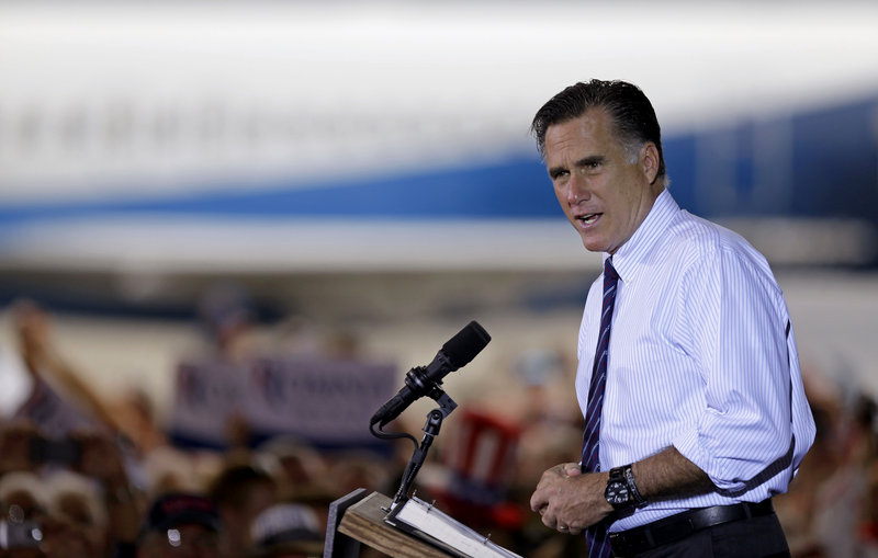 "Republican presidential candidate Mitt Romney speaks at a campaign event in Sanford, Fla., the day before the election. A reader calls on columnist M.D. Harmon to ""take a cue from Mitt Romney's concession speech urging our citizens to support the president and pray for him."""
