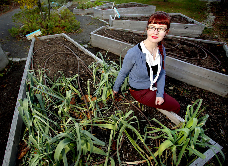 Holly Seeliger, seen in the Reiche Elementary School Community Garden, was elected last week to the Portland School Committee. A headline on a recent story unfairly emphasized Seeliger's experience as a burlesque dancer at the expense of her qualifications for the school board, a reader says.