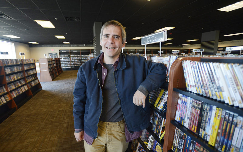 Bull Moose's Brett Wickard spends time in his new Mill Creek store.