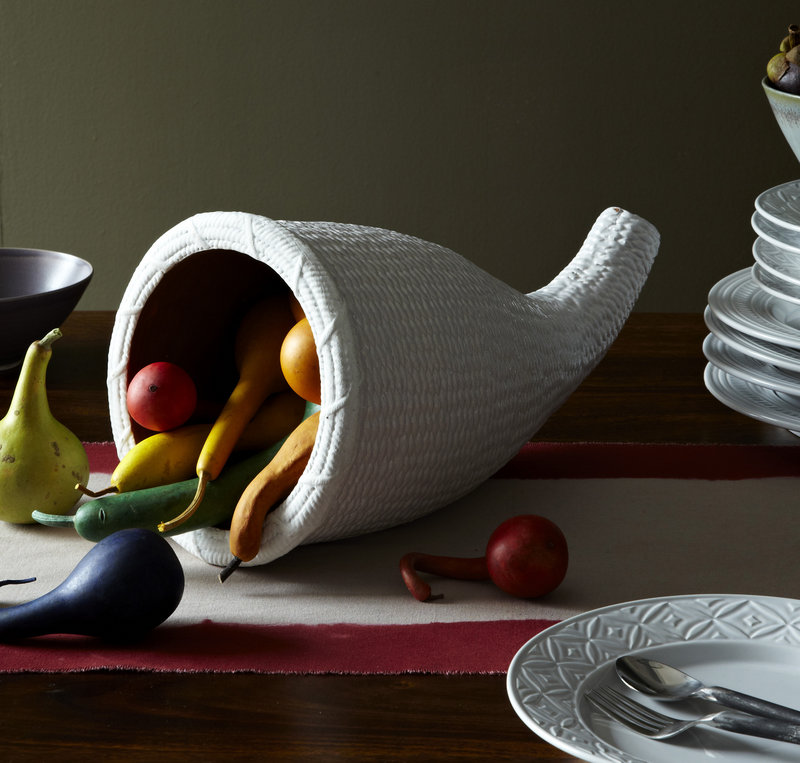 West Elm's terracotta cornucopia is filled with seasonal gourds.