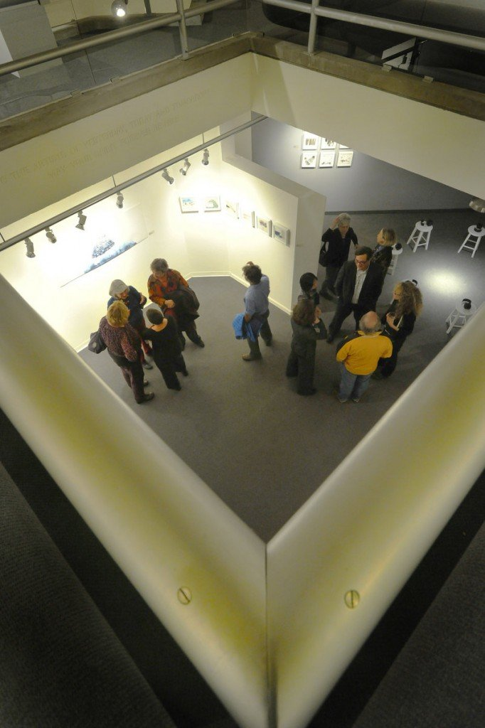 """Artists and gallery goers mingle at a recent gathering of the artists of """"Maine Women Pioneers III: Vanguard."""""""