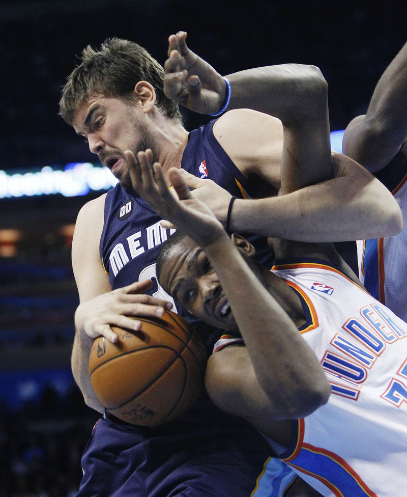 Marc Gasol of the Memphis Grizzlies has a hold on the ball as well as Kevin Durant of the Oklahoma Thunder during Memphis' 107-97 victory Wednesday night.
