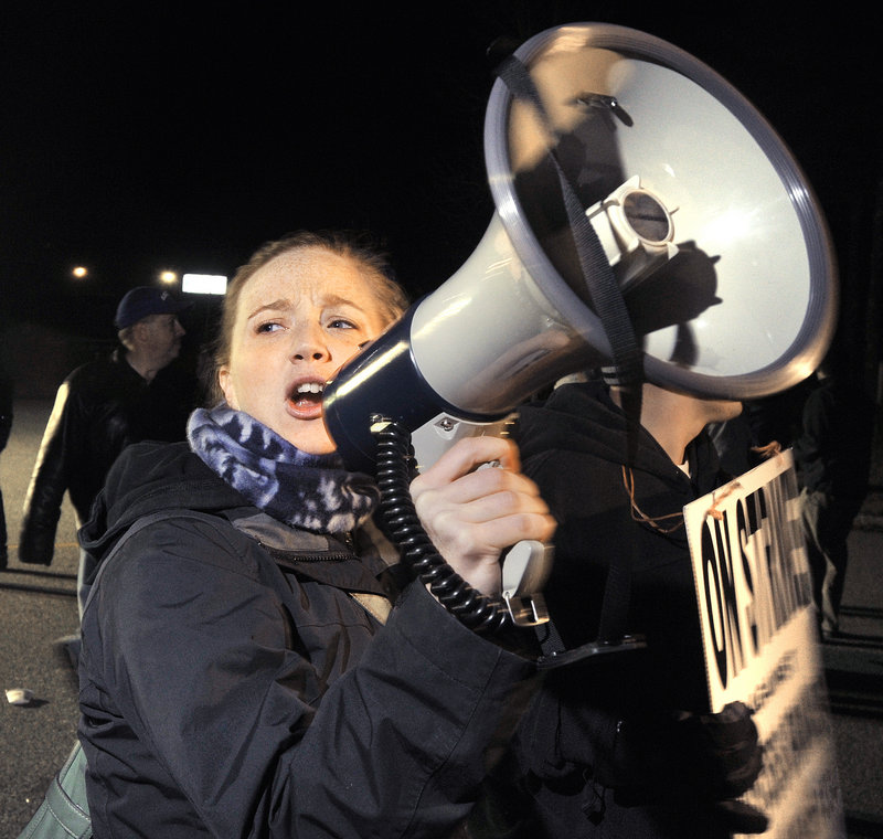 Tracy Allen Urquhart, from Hallowell, uses a megaphone to lead chants during the strike.