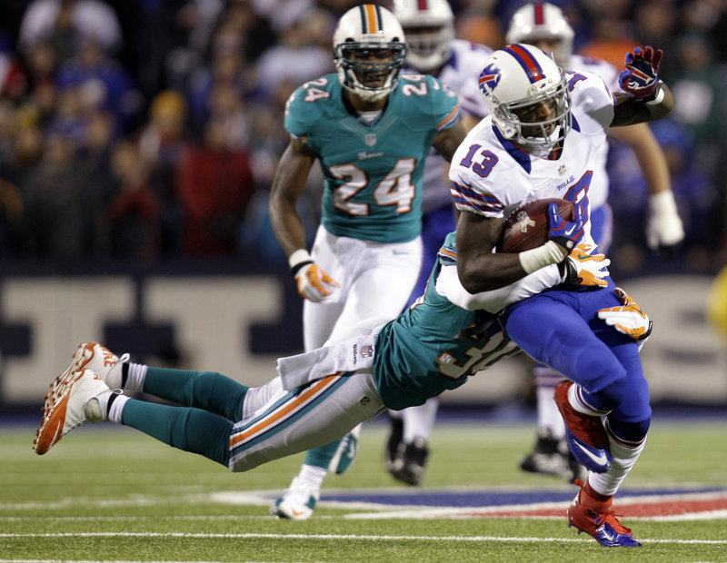 Stevie Johnson of the Buffalo Bills is brought down by strong safety Chris Clemons of the Miami Dolphins during the first half of the Bills' 19-14 victory Thursday night.