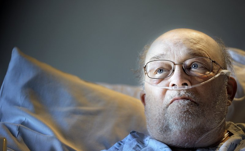 Joseph Stackpole is shown in his hospital bed at Maine Medical Center on Oct. 26. Stackpole lived long enough to see Maine voters approve same-sex marriage on Election Day.