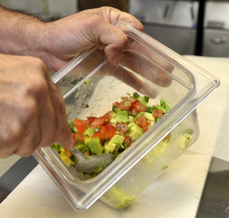 The avocado, cilantro, tomato, scallions and seasonings for the arepas are mixed fresh every hour or so.