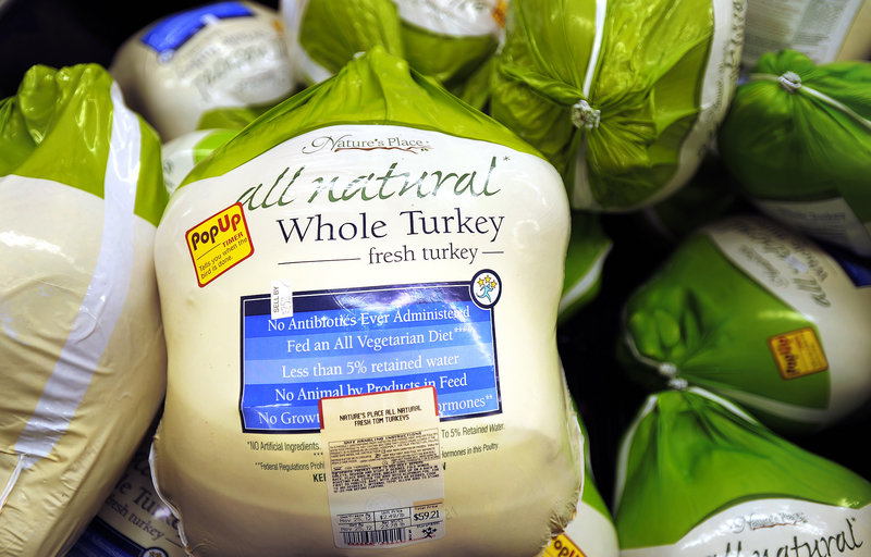 Frozen turkeys, at 49 cents a pound, sit at a Portland Hannaford store. The top local price for a frozen turkey last week was $1.89 a pound at Whole Foods.