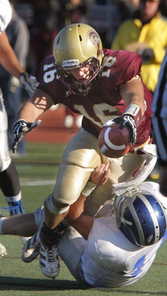 Andrew Libby of Thornton Academy stretches to get the ball across the goal line as Keenan Scanlin of Lawrence makes the tackle.