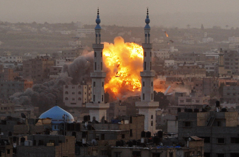 An explosion rises from an Israeli airstrike in Gaza City on Saturday. Israel bombarded the Gaza Strip with at least 300 airstrikes Saturday.