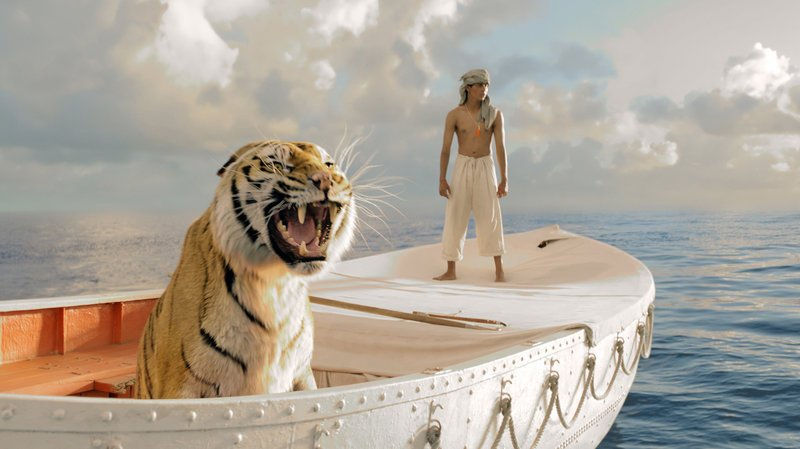 "Suraj Sharma plays the young Pi, who finds himself sharing a boat with a Bengal tiger named Richard Parker in ""Life of Pi."""