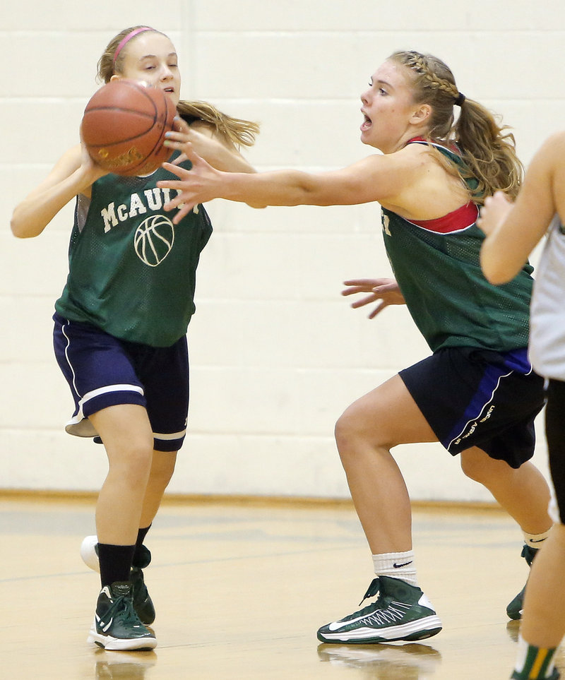 Mikayla Moran tries to get the ball past the outstretched arms of teammate Ayla Tarte during a defensive drill.