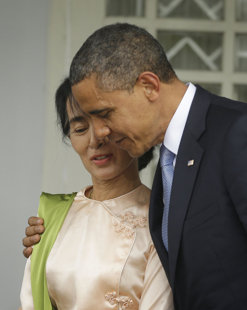 President Obama walks Monday with Myanmar opposition leader Aung Sun Suu Kyi at Suu Kyi's residence in Myanmar.
