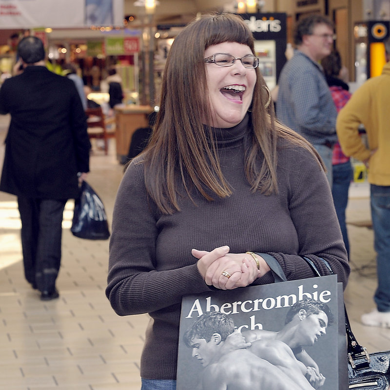 "Susan Perkins of Fairfield says she likes shopping at the Maine Mall when the crowds are smaller. ""There's already great sales,"" she said Tuesday."