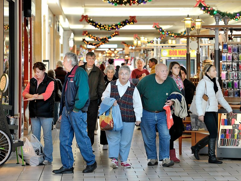 Shoppers stroll the corridors of the Maine Mall on Tuesday, beating Black Friday crowds and taking advantage of the fact that retailers are holding sales earlier in the season, including events tied to Veterans Day.