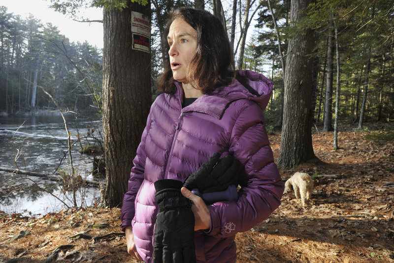 Sara Lennon of Cape Elizabeth walks the property off Shore Road known as Robinson Woods II. She said the town's $350,000 contribution shows the high priority residents place on open land.
