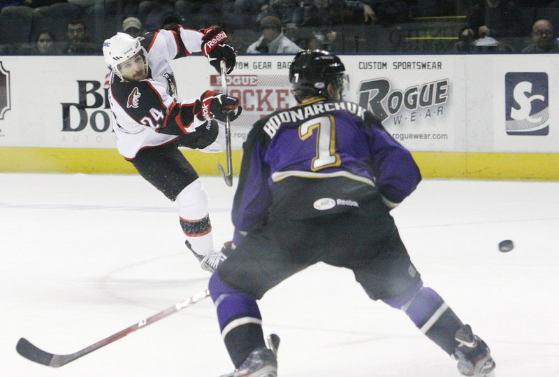 Brett Hextall of the Pirates take a shot on goal at the end of the second period Tuesday night. The Pirates were punchless in a 5-1 loss to the Monarchs.