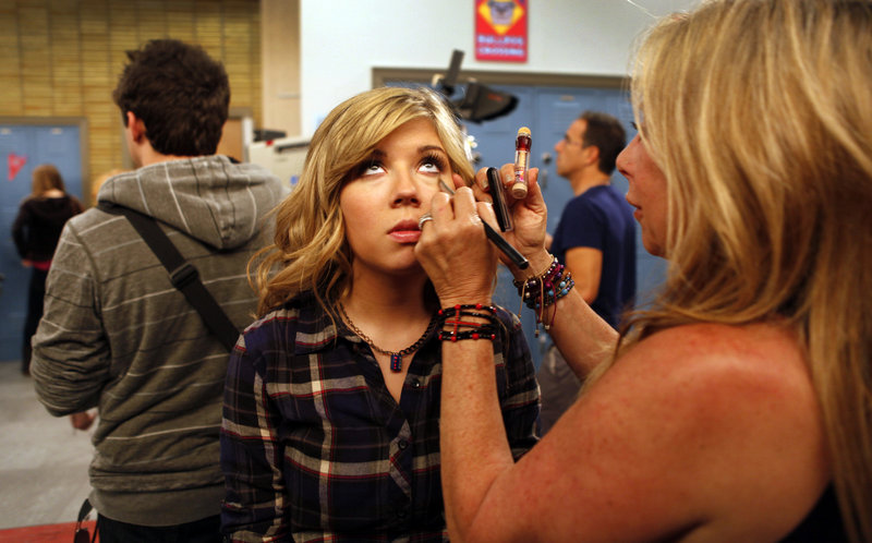"Jennette McCurdy, as ""Sam Puckett,"" gets a makeup touch-up during taping on the set of ""iCarly,"" in Hollywood. The Nickelodeon series is coming to an end after five seasons."