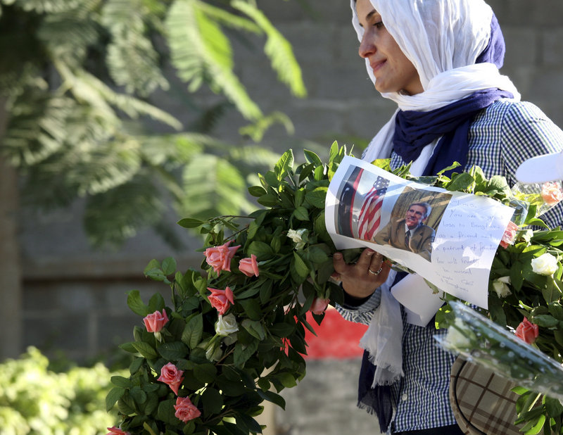A Libyan woman pays her respects during a service for those killed in the Sept. 11 attack on the U.S. Consulate in Benghazi.