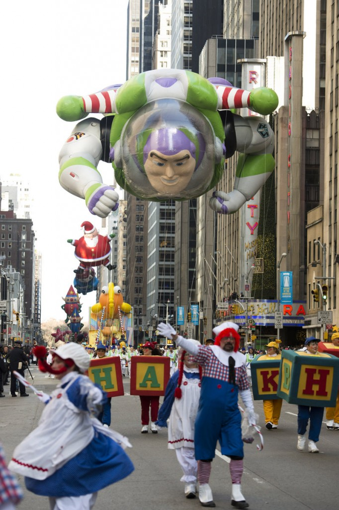 The Buzz Lightyear balloon floats in the Macy's Thanksgiving Day Parade in New York on Thursday. Meanwhile, Mayor Michael Bloomberg's office was coordinating the distribution of 26,500 meals at 30 sites in neighborhoods affected by Superstorm Sandy.