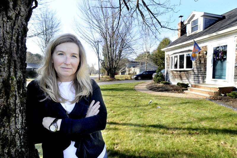 Amy Williams, a neighbor of the public works garage, questions the wisdom of spending $375,000 to acquire an adjacent house to create 11 parking spots.