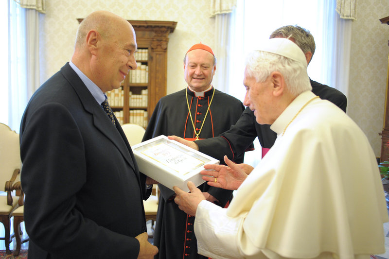 "Pope Benedict XVI holds a copy of his book ""The Infancy Narratives: Jesus of Nazareth"" as he meets with RCS Publisher Paolo Mieli, left, and Cardinal Gianfranco Ravasi, at the Vatican Tuesday."
