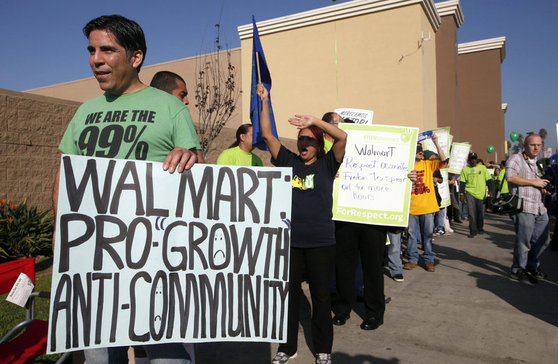 Anthony Degoege protests outside a Walmart store in Paramount, Calif., on Friday, as Walmart employees and union supporters took part in nationwide demonstrations for better pay and benefits.