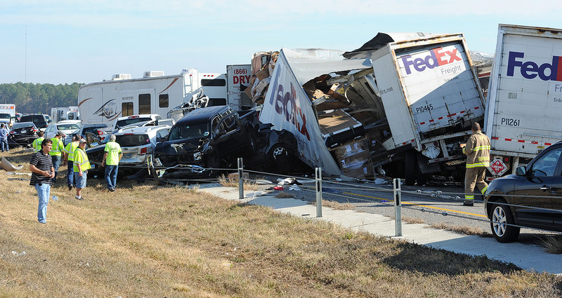Vehicles are piled on Interstate 10 in southeast Texas on Thursday. The Texas Department of Public Safety said two people were killed and more than 80 were injured when at least 140 vehicles collided in dense fog.