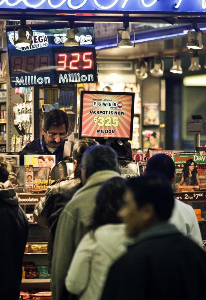 New Yorkers wait in line Friday to buy Powerball chances. The jackpot has climbed to $325 million, the fourth-largest in the game's history.
