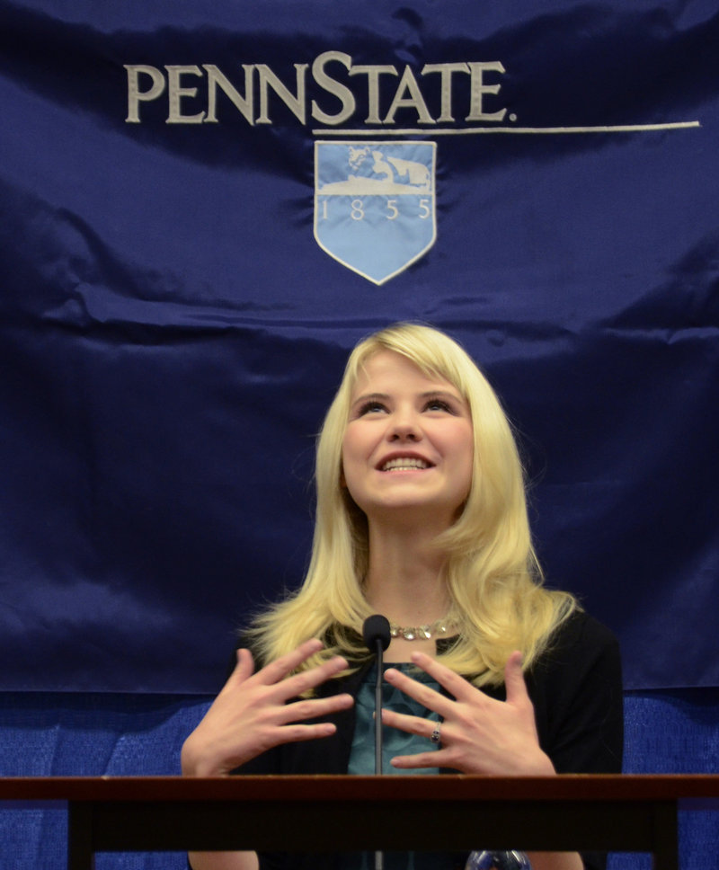 Elizabeth Smart speaks to reporters at the Child Sexual Abuse Conference in State College, Pa., in October. Smart, who was abducted in 2002 and held prisoner for nine months, is working on her account of the experience.