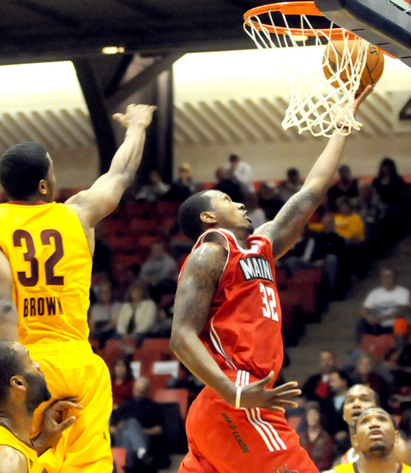 Kris Joseph, who finished with 28 points and eight rebounds for the Maine Red Claws, drives past D'Aundray Brown of the Canton Charge. Joseph helped the Red Claws open the season with a 123-115 victory on the road.