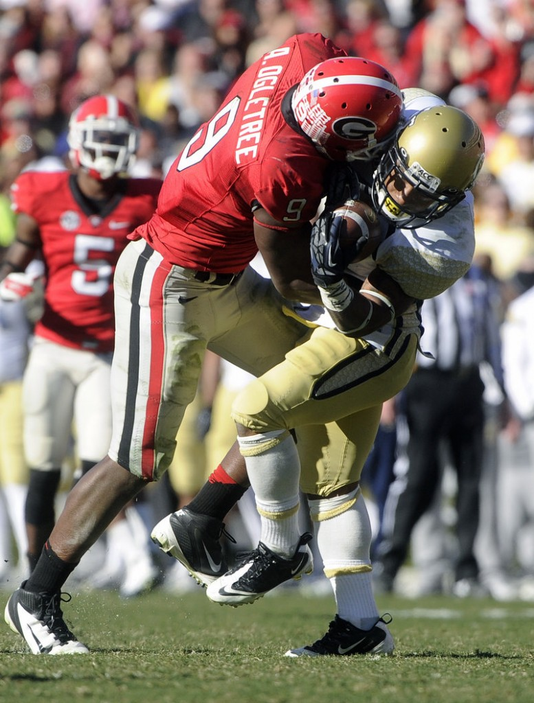 Georgia linebacker Alec Ogletree puts a hard hit on Georgia Tech's Synjyn Days, and the Bulldogs went on the beat the Yellow Jackets 42-10 in Athens, Ga. on Saturday.