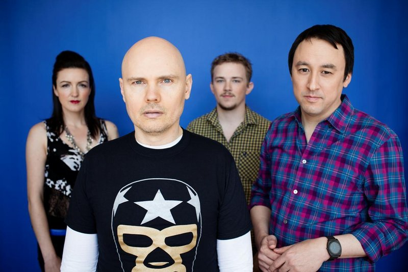 The lineup of Smashing Pumpkins is, from left, bassist Nicole Fiorentino, frontman Billy Corgan, drummer Mike Byrne and guitarist Jeff Schroeder. The Pumpkins play the State on Saturday.