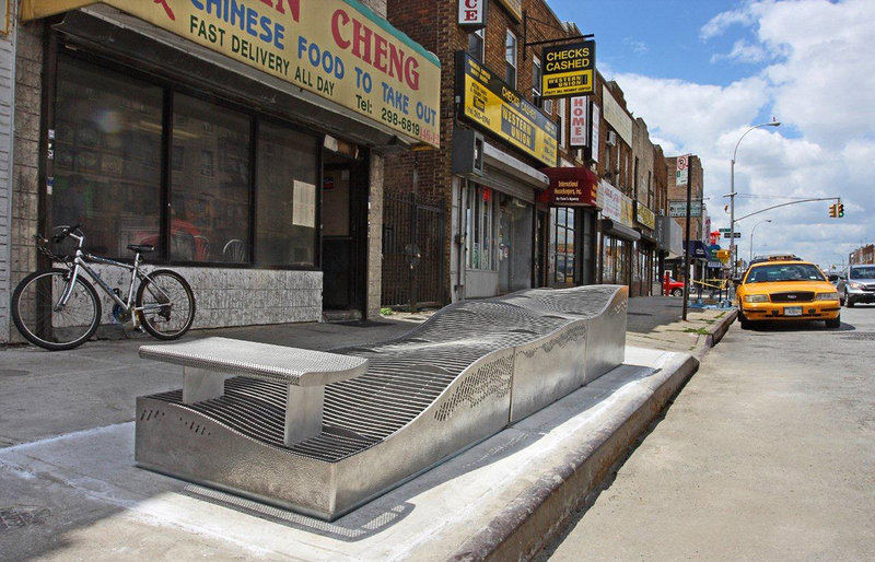 A raised ventilation grate doubles as street furniture installed to limit subway flooding from rain on Hillside Avenue in the Queens borough of New York. The raised grates were designed to deal with flooding from rain, not the deluge generated by Superstorm Sandy.