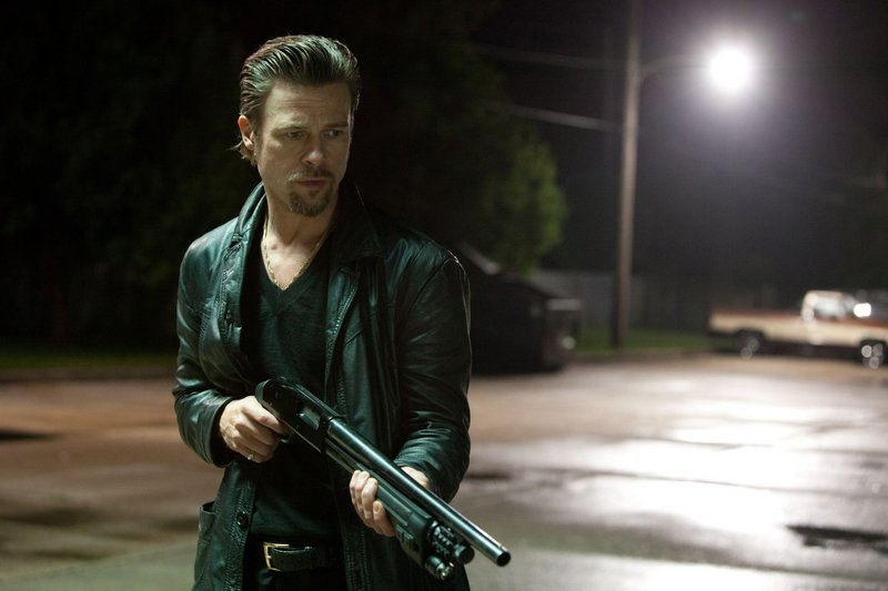 "Brad Pitt and James Gandolfini (below) are uneasy allies in ""Killing Them Softly."""