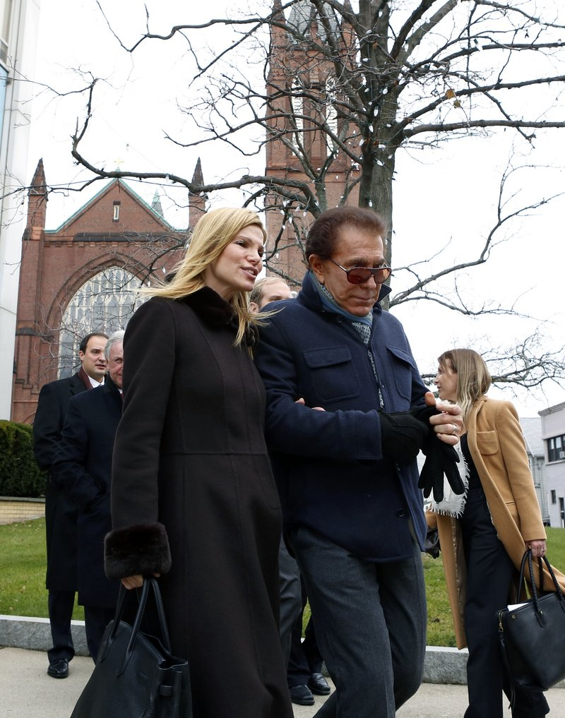 Casino mogul Steve Wynn and his wife, Andrea Hissom, leave City Hall Wednesday in Everett, Mass., where Wynn may apply to build a gambling resort.