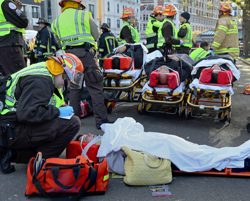First responders tend to some of the injured after two trolleys collided in a subway station on Thursday, Nov. 29, 2012 in Boston. An MBTA spokesman says six people were taken the hospital and more than 20 others were evaluated. T spokesman Joe Pesaturo says there was no derailment and no visible damage to either two-car trolley after the slow-speed accident just before noon on Thursday in the Boylston Street station.