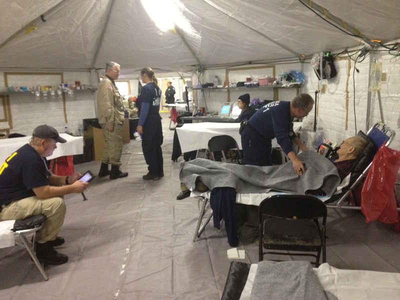 A staffer attends to an evacuee from a nearby nursing home in the fully equipped acute care tent that's part of the temporary medical facility erected at Lehman College in the Bronx after Hurricane Sandy.