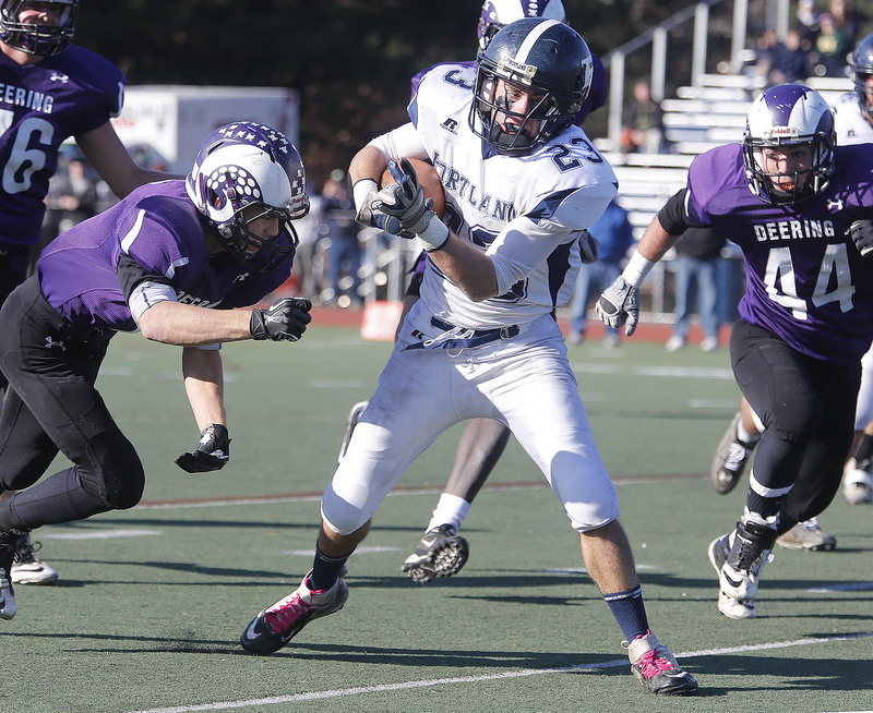 Nick Volger, playing his final game for Portland, attempts to elude a tackler at Fitzpatrick Stadium. Deering won for the 10th time in the last 11 games.