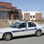 In this March 2008 file photo, a police cruiser sits in front of Cape Elizabeth High School. Police are investigating a Friday, Dec. 10, 2012 marijuana-cookie incident that led to the suspension of nine Cape Elizabeth High School students.