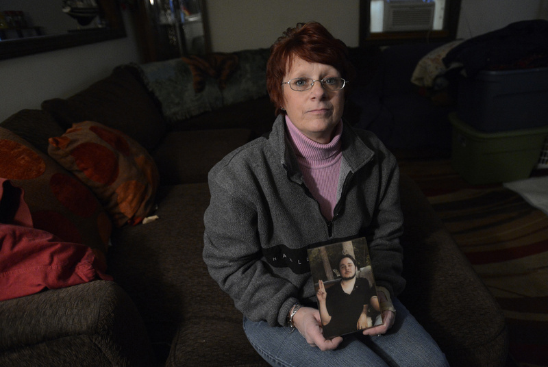 Sharon O'Brien holds a family photo of her nephew, Andrew Landry, at the family's home in Sanford last week. O'Brien, who was with Landry the night he was shot and killed by police in Lyman in January 2011, says she believes her nephew reacted after being put on the defensive.