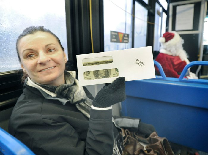 Aneta Rosa from Westbrook was one of many lucky Metro bus riders to receive a $100 bill from the Secret Santa who rode the bus from Westbrook to Portland and back to Westbrook on Friday.