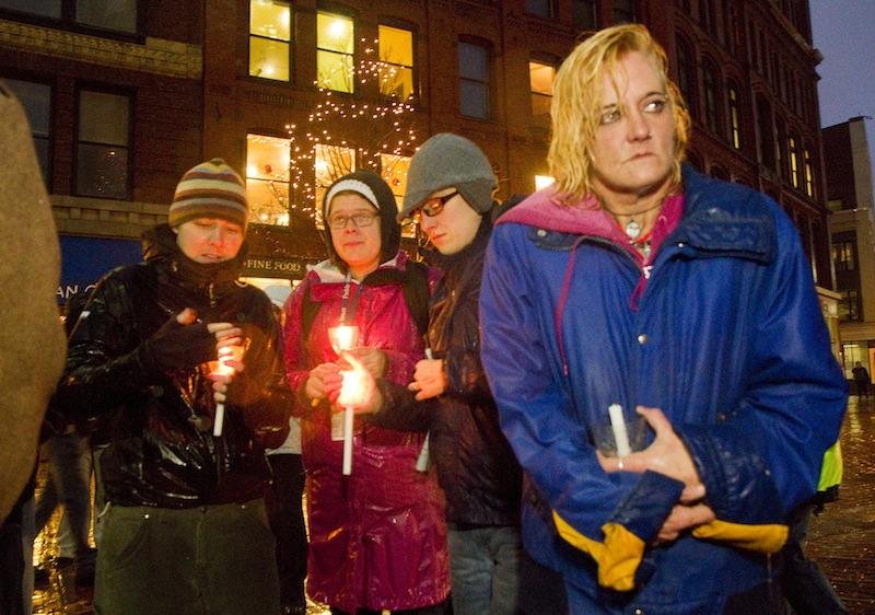 Sherri Ferrier, participates in the annual homeless vigil at Monument Square on Friday. Participants announced the names of 30 homeless people who died in the past year. Ferrier, who recently moved into a shelter, was there to remember her friend Deb, among others.