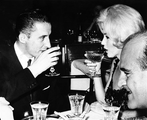 Marilyn Monroe and Jean Pierre Piquet, left, manager of Continental Hilton Hotel, lift their champagne glasses at a Feb. 26, 1962, reception offered to the visiting star, in Mexico City. The FBI has released a new version of files it kept on Monroe that reveal the names of some of her acquaintances who had drawn concern from government officials and members of her entourage over their suspected ties to communism.