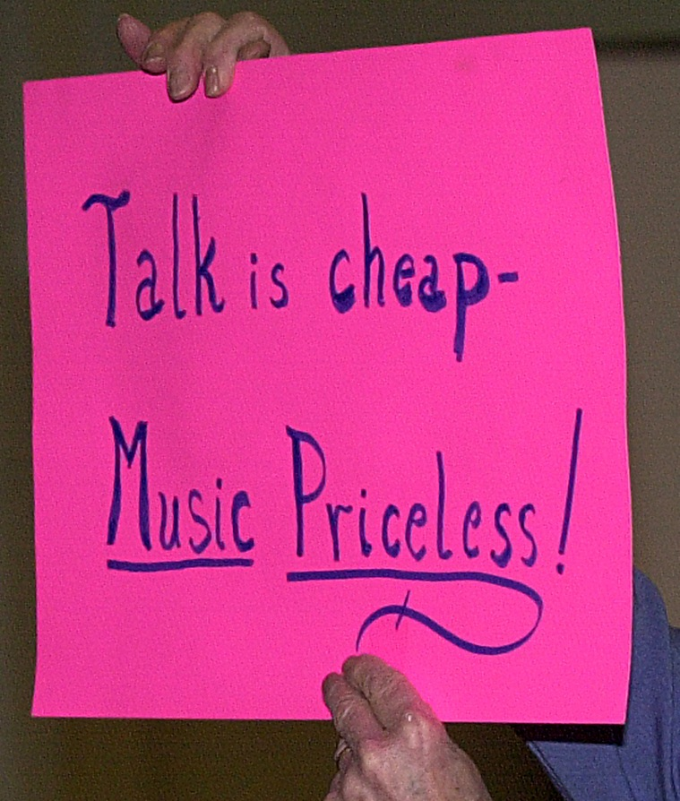 A sign protesting a Maine Public Broadcasting music-program cutback in 2001 expresses the feelings of some readers about the radio network's newly announced changes in programming.
