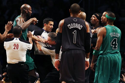 Boston Celtics' Kevin Garnett, far left, and Brooklyn Nets forward Gerald Wallace, third from right, are separated by officials in the second half of their NBA basketball game at Barclays Center Tuesday in New York. Boston won 93-76.