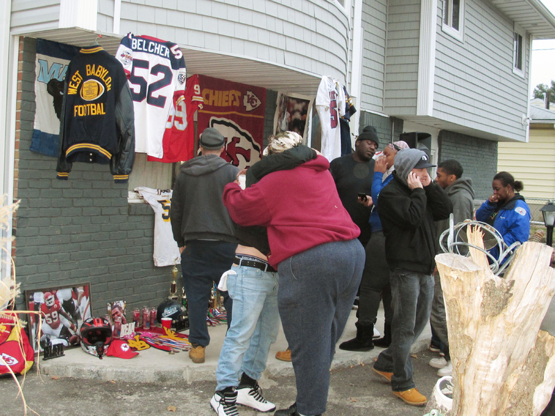 Friends and relatives of Jovan Belcher, the former University of Maine player and linebacker for the Kansas City Chiefs, grieve Saturday outside the Belcher family home in West Babylon, N.Y.