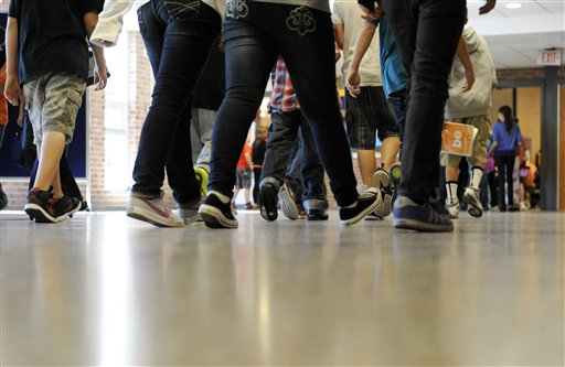 Students make their way to class at Draper Middle School in Rotterdam, N.Y., recently. School for thousands of public school students is about to get quite a bit longer.