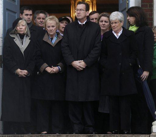 Connecticut Gov. Dan Malloy, center, stands with other officials to observe a moment of silence while bells ring 26 times in Newtown, Conn., in honor of the Sandy Hook Elementary School victims.