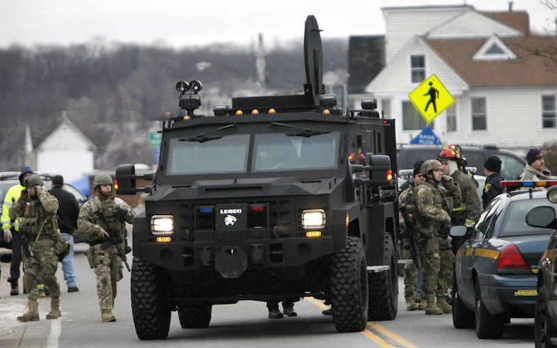 A Monroe County Sheriff's Department armored truck drops off residents who were evacuated from the neighborhood where two Webster firefighters were killed and two others were wounded by a gunman on Monday morning. Seven houses were destroyed. The gunman died of a self-inflicted gunshot wound.